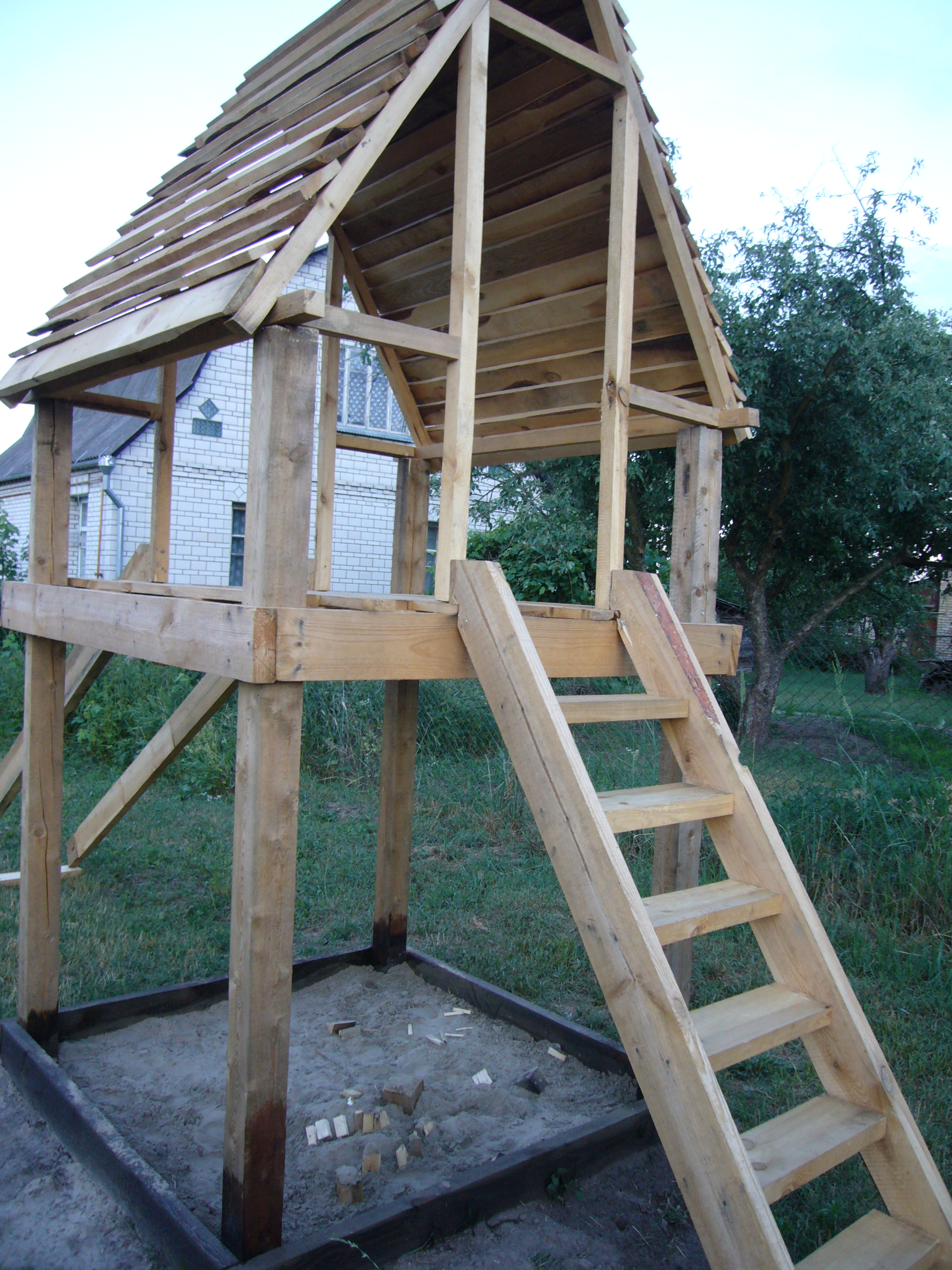 Diy project wood playhouse with slide diy crafts for Diy pool house plans